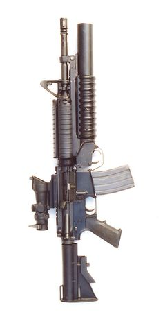 M4 carbine (5.56 NATO) with ACOG sight and attached M203 40mm grenade launcher, a fine piece of military hardware
