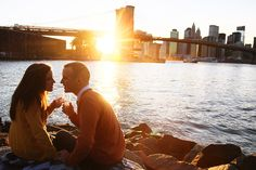 Engagement photo-session | cute couple drinking champagne - romantic sunset photo - NYC skyline and Brooklyn Bridge | New York photos | Engagement Photography | Photo-session price : $350 when booked together with Wedding-day photos  | Anna Rozenblat Photography  | www.AnnasWeddings.com
