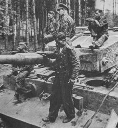 "The crew of ""Tiger"" 3rd SS Panzer Division ""Totenkopf"" is resting on the armor of his car"
