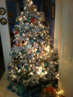 Coastal Beach Theme Christmas Tree. Lots Of Ornaments With Fish, Santa On A  Surf