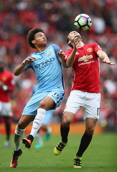 Leroy Sane of Manchester City challenges Daley Blind of Manchester United during…