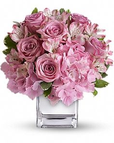 pink hydrangea, lavender roses and pink alstroemeria accented with fresh greenery.