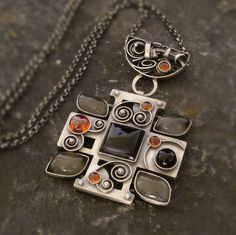 Multi Stones Amulet Pendant by Norman Man - product images of SCHJ Metal Fab, Handmade Jewelry, Unique Jewelry, Norman, Sterling Silver Jewelry, Pendants, Necklaces, Pendant Necklace, Jewellery