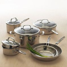 Food Network Tri Ply Stainless Steel pan set. Kohl's had these on sale at some point for $300. Sometimes you can get a discount with coupons. Basically the same set as the EmerilWare. My Indian friend said these are perfect sizes for cooking Indian and everyday food, she uses them all the time.