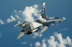 An US Air Force F-16C Fighting Falcon from 18th Aggressor Squadron, Eilson Air Force Base, departs after refuelling from a Boeing KC-10 Extender of 32nd Air Refuelling Squadron, Joint Base McGuire-Dix-Lakehurst during Exercise Valiant Shield, September 2014.
