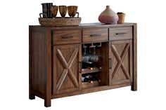 """Series Name:Waurika Item Name:Dining Room Server Model #:D644-60 Dimensions:54""""W x 18""""D x 36""""H Weight:155 lbs   The rich rustic design of the """"Waurika"""" dining collection features a warm medium brown finish that has a rustic appearance flowing beautifully over the thick built up table tops and stylish """"X"""" table base design creating a relaxed inviting atmosphere to enhance any dining experience."""