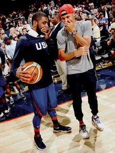 1030s:Stephen Curry and Kyrie Irving chatting during the...