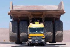 Mercedes semi-truck pulling a 345-ton Mining Truck. Really?