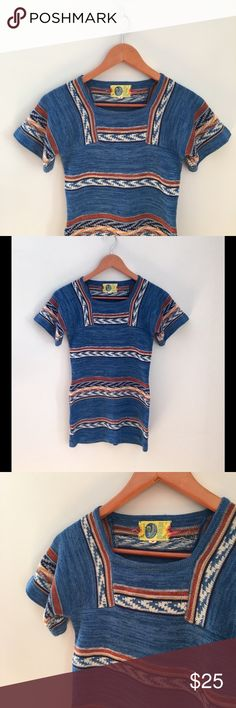 Amazing 70s Vintage Knit Top Trying to summon your inner hippie? If so, this beautiful vintage top is definitely for you! Features lovely blue/cognac complimentary colors, square neck and slightly flared/bell short sleeves. Tagged as a medium but wears like a present day XS-S. In great condition, no tears or stains upon inspection. 100% acetate. Make an offer! Usually able to ship within 24 hours or less ✌️ Vintage Tops