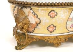 Very nice and delicate porcelain planter, East India Company, 18th Century.  Gild bronze surrounding set with lion heads and flower. Decor of two figures discussing  on the seashore. For sale on Proantic by Luc de Laval Antiquités.   #eastindiacompany   #planter   #18thcentury
