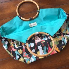 NEIMAN MARCUS tote bag. So cute. Like new. Like new Neiman Marcus tote bag with wooden handles medium size with urban scene. Great small beach bag or medium bag for necessities. Lining is a nylon wipeable fabric. So cute! Neiman Marcus Bags Totes