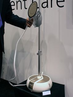 Panasonic's 2-in-1 Garment Steamer ($179) promises to help you get the really tough creases out. This unit works like a standard steamer, but the attachment features Panasonic's patented elliptical soleplate, so it also functions like a pint-sized steam iron to get out deeper wrinkles. #ihhs13 #panasonic #steamers