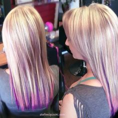 Pastel pink and purple highlights on blonde hair.