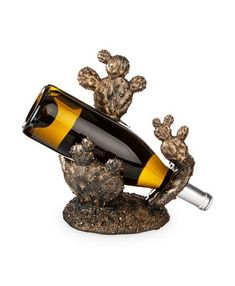 Add a dose of southwestern influence to your space with the cactus design of the Foster & Rye Cactus Bottle Holder . This bottle holder is made from. Bottle Wall, Wine Bottle Holders, Hanging Wine Glass Rack, Wine Rack, The Fosters, Capricorn Man, Sloth, Cookware