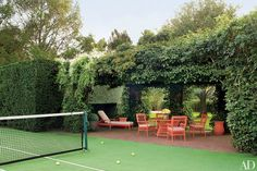 Tennis court with ivy-covered terrace