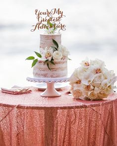 """Wedding cake + sequined cake table linen + bouquet + """"you're my greatest adventure"""" cake topper. Florals by Petals. Christie Graham Photography"""