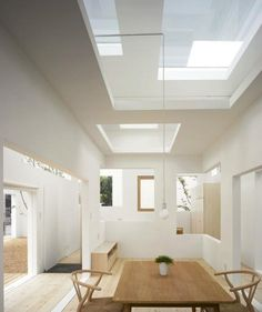 Opening in roof allow light to penetrate dinning room from up above