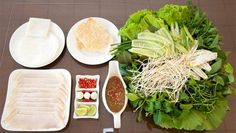 anh trang cuon thit heo, it's as simple as rolling dry pancake with pork and vegetables and herbs, dipping in the sauce then enjoy.