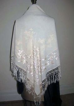 A very pretty antique hand-embroidered Canton fringed scarf or shawl having alternate corners embroidered in gorgeous fat silk art floss which was