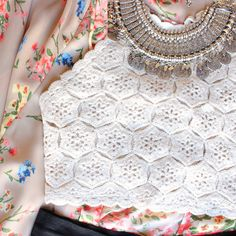 Cream colored halter crochet crop top that features a tie neck and back. Fully lined. Imported. Digging the boho vibe. Seen styled with our floral kimono jacke