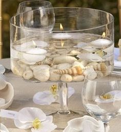 For this Beach Centerpiece, water and floating candles are added to the seashell mix.