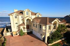 THE RITZ IN DUCK, #273 | Duck, NC Vacation Rental Home | Oceanfront, 8 master suites, elevator, sports bar, home theater, library, exercise equipment, private heated pool, poolside cabana, hot tub and private beach walkway. l Special pricing weeks of 7/5/14, 7/12/14, 7/19/14 and 8/30/14. l www.CarolinaDesigns.com