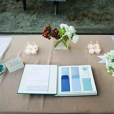Brides: Blue Mini-Envelope Guestbook. For the guest book, Rebecca pasted mini-envelopes from Paper Source into a Kolo photo album.