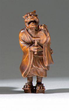 """WOOD NETSUKE Meiji Period By Shoko. In the form of a standing oni playing a drum. Signed. Height 2.3"""" (6 cm). With kiriwood box."""