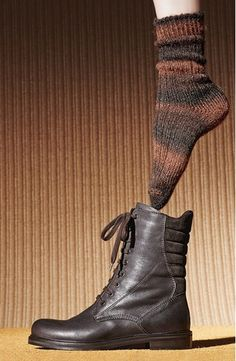 Trapunto-stitch suede lends quilted texture to the back of an edgy lace-up boot built with a side zipper for easy on and off. A signature weatherproof finish protects the supple leather and suede, prolonging the life of your investment and keeping you looking impeccable even in wet, rainy conditions. @Nordstrom