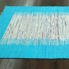 Tabuk Rug in Turquoise - fresh and summery. It's like a beach vacation in a rug.