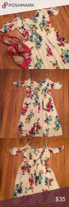 Audrey Spring Floral Dress Beautiful floral spring dress.  Inside slip.  100% Polyester Audrey  Dresses
