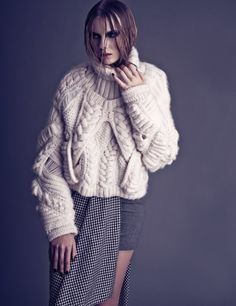 Gorgeous sweater. I can't find a credit for the design anywhere. Drat.