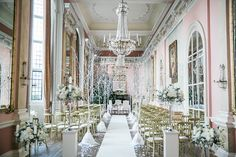 For a winter wedding like no other, you need to see interior designer Anouska and husband Greig's glittering blush and silver wedding decor! This creative couple's December wedding brought their twinkling tree-lined wonderland aisle to life with blush and gold birds, baubles and tea lights too..