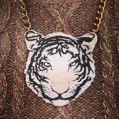 Grrr! Lucy teams our Tiger Necklace with a sparkling glitter knit for ferocious cool: http://www.tattydevine.com/tiger-necklace-2967.html
