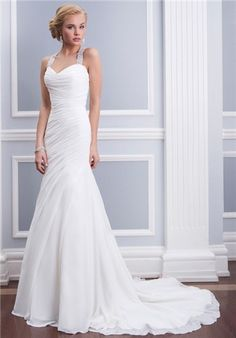 Absolutely beautiful wedding dress. Chiffon fit and flare features asymmetrical pleating and a beaded halter neckline with a criss-cross keyhole back. Gown has chapel length train and chiffon buttons cover the zipper.