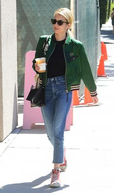 Emma Roberts tosses a bomber jacket over her simple jeans and tee look