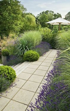 create a lush garden...great use of grasses to fill in a space, and take note that much of this garden is foliage…