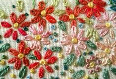 Embroidered Flower Gardens: Daisies – Needle'nThread.com example of varied colors using turquoise as the leaf