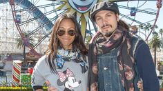 """Actress Zoe Saldana celebrated New Year's Eve in Disney-style with her husband, Marco Perego, at Disney California Adventure park. This was one of Zoe's last stops before she begins filming """"Guardians of the Galaxy 2"""" in which she reprises"""