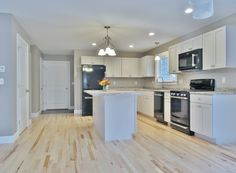 Large kitchen with center #island and #hardwood