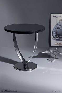 CHICAGO - Side Table Glossy black lacquered top with brushed and polished stainless steel base. Dim: Ø 60 x 68 cm.