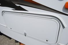 Seems like a good and practical idea - Adding rain gutters over storage area doors