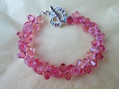 Pretty in PINK Swarovski Rock Candy Bracelet with matching Swarovski silver and pink toggle clasp! visit BDFCreationz.etsy.com  Thanks for looking hugzzzzzz