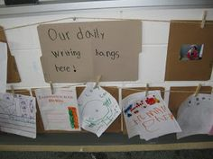 "Providing the children with the opportunity to display their writing ("",)"