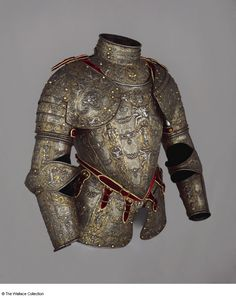 Partial armour Lucio Marliani, called Piccinino (1538 - 1607) Milan, Italy c. 1570 - 1590 Very low-carbon steel, gold, silver, copper alloy, leather, gold braid and velvet, embossed, gilt, blackened, and damascened Weight: 10.9 kg, total weight A51 European Armoury II
