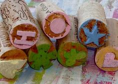 Stamps made from corks. You can also do this with those white erasers (like the Pentel Hi-Polymer erasers).