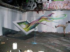 """The 6 Best Graffiti Optical Illusions - Likes """"The picture in the 3D optical illusion looks like it would be more likely to paint you instead of you painting it. This optical illusion is one of a kind and it comes complete with its own shadow. """""""