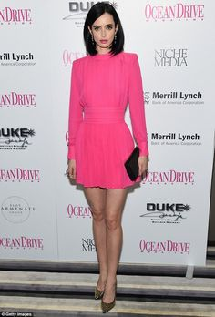 Who is this dress by?!?! Must know! Superhero sexy: Krysten Ritter showed off her toned legs in a hot pink mini dress as she a...