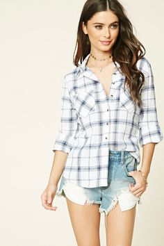 A woven tartan plaid shirt with a basic collar, a buttoned front, chest patch pockets, and 3/4 roll-tab sleeves.