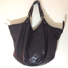 Sigrid Olsen 100% Leather Black Large Hobo Purse This purse is a beauty in great condition with the exception of a little cracking and wear on the inner edge of the shoulder straps. Otherwise not rips, stains, scratches, etc. inside or out. There is a clasp shown in pic 1 and 2 which closes from either aid of the bag in the middle that acts as a would-be zipper. Pic 3 shows clasp shut as would be the case of you wore it. Sigrid Olsen Bags